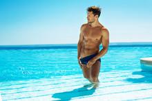 Muscular Handsome Man Posing In Swimming Pool