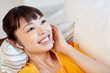 happy asian woman with earphones listening music