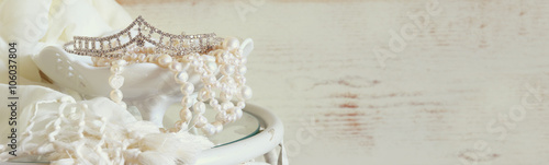 website banner background of white pearls necklace and diamond tiara on vintage table Fototapete