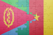canvas print picture - puzzle with the national flag of eritrea and cameroon