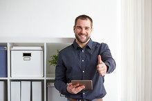 Happy Businessman With Digital...