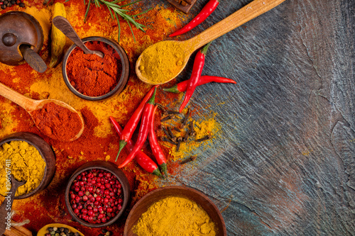 Fotografering  Various spices on black stone