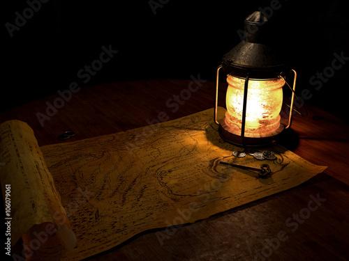 Fotografie, Obraz  Lantern & Map A ships lantern lights an old treasure map with a key