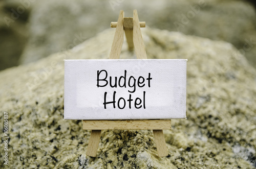 conceptual image, word BUDGET HOTEL on white canvas frame and wooden ...