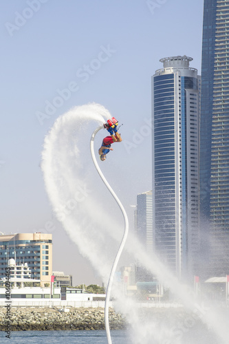 Poster Nautique motorise man on flayborde doing flip jump in international competitions in extreme water sports in Dubai, United Arab Emirates