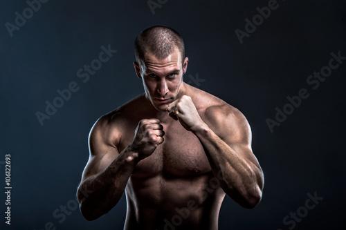 Obraz na płótnie tough muscular powerful male fighter portrait