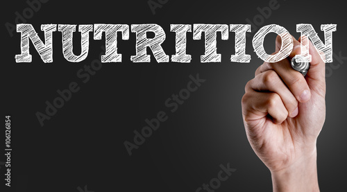 Hand writing the text: Nutrition