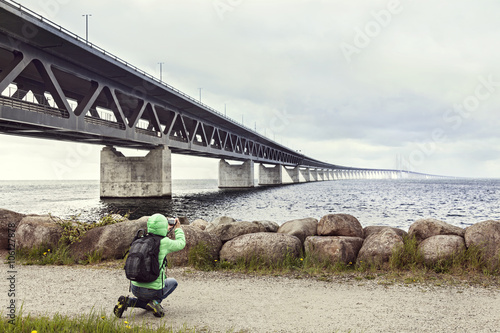 Female tourist taking pictures  the Oresund bridge Tablou Canvas