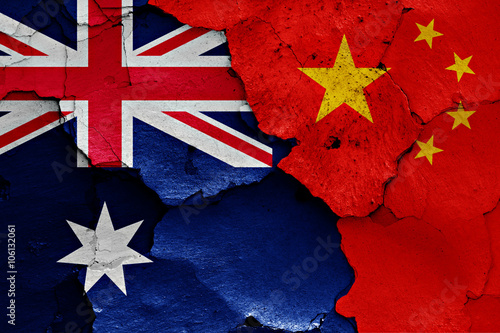 Fotobehang China flags of Australia and China painted on cracked wall