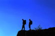 canvas print picture - Man and woman on the top of the mountain