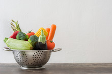 Healthy Eating. Clean Fresh Vegetables In Metal Colander On A Wooden Table.