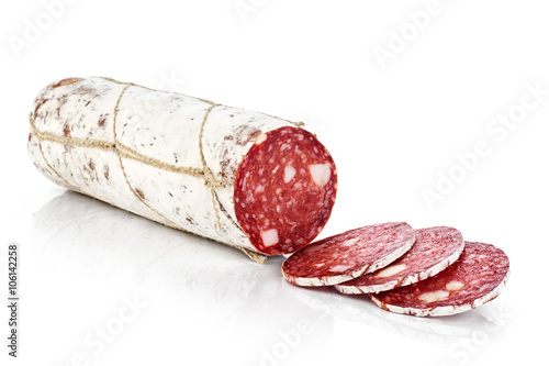 Valokuvatapetti Dried salami with white mold isolated on white background.