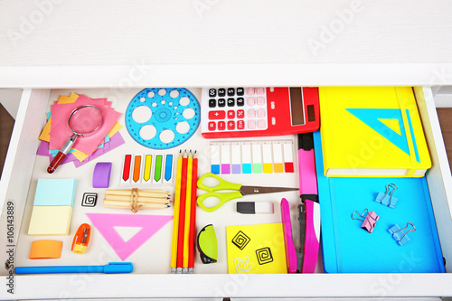 Stationery in open desk drawer, top view - Buy this stock