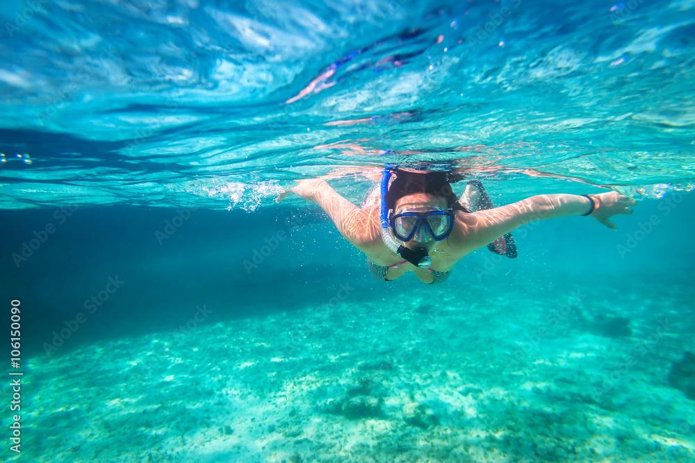Fototapeta Beautiful women snorkeling in the tropical sea