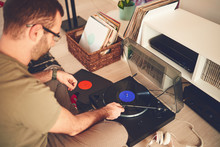 Male Putting Needle On Vinyl. Listening Music At Home