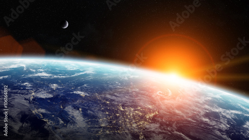 Sunrise over planet Earth in space Wallpaper Mural