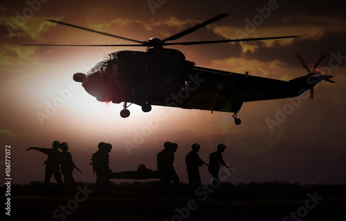 Fotografie, Obraz Military rescue helicopter during sunset