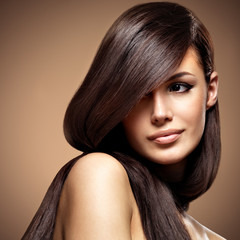 Fototapeta Do fryzjera Beautiful young woman with long straight brown hair.