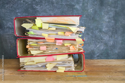 Fotografía  stack of messy file folders and documents,free copy space