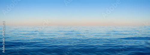 Foto op Aluminium Zee / Oceaan Panorama of sea waves on the background of dawn