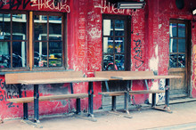Street Cafe In Amsterdam With Graffiti On The Shabby Wall