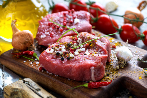 Fresh raw beef steak on wooden background Tablou Canvas