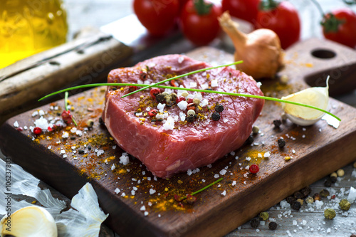 Fresh raw beef steak on wooden background Fototapet