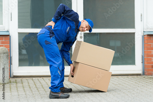 Fotografie, Obraz  Delivery Man Suffering From Backpain