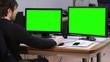 Nervous breakdown man in office green screen monitors. A man having a nervous breakdown in his office. Green screen dual monitors. Full HD