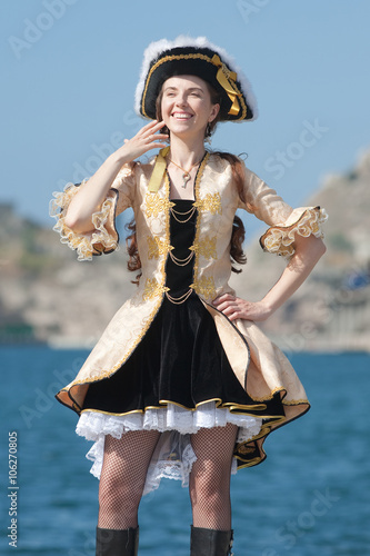 Poster Gypsy Portrait of young woman in pirate costume outdoors