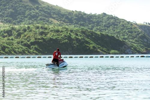 Poster Nautique motorise Man on Jet Ski having fun in Ocean