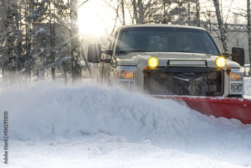 Photo  Snow plow doing snow removal after a blizzard