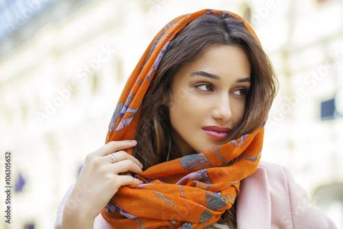 Valokuvatapetti Close up portrait of a muslim young woman wearing a head scarf