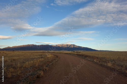 Foto op Aluminium Oranje eclat Mirrored Swoosh in Clouds and Dirt Road