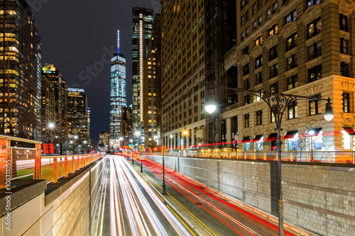 Obraz Traffic trails in downtown New York City at the entrance in Battery Park tunnel - fototapety do salonu