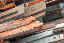 Pile Of Old Used Timber Planks. Old, Rotten, Scrapped Floorboards And Decking Planks Amassed And Scattered In Heap.