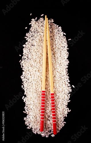 Rice with chopsticks on a dark background Canvas Print