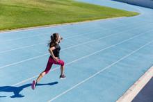 Runner Sprinting Towards Succe...