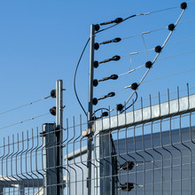 View Of An Electric Fence Installation On A Metallic Grilled Fence