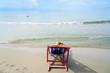 Woman lay on pink beach chair