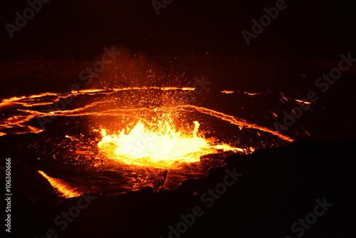 Deurstickers Vulkaan Smoking volcano Erta Ale in the night