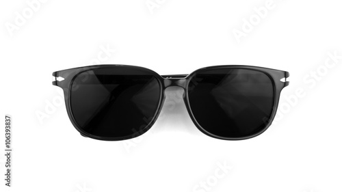 Cool sunglasses isolated on white background. In black plastic frame. Top view. Close up.
