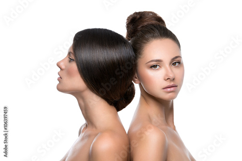 Obraz na plátne  Two beautiful girls with perfect skin