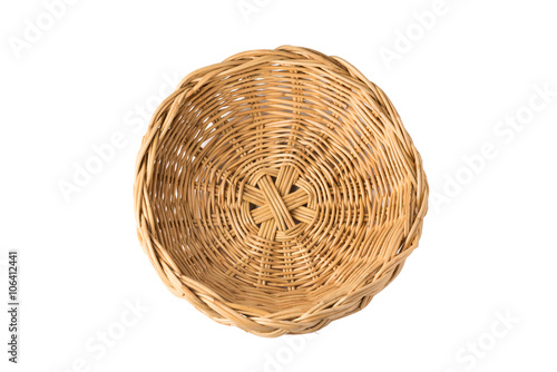 Fotografija  top view of vintage  weave wicker basket isolated on white background