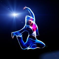 Fototapeta Female hip-hop dancer jump in the dark