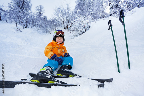 d0d1e5508d Little skier boy rest in snow wear ski outfit - Buy this stock photo ...