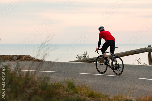 Photo sur Toile Cyclisme Early Morning Road Cycling along the Coastal Highway