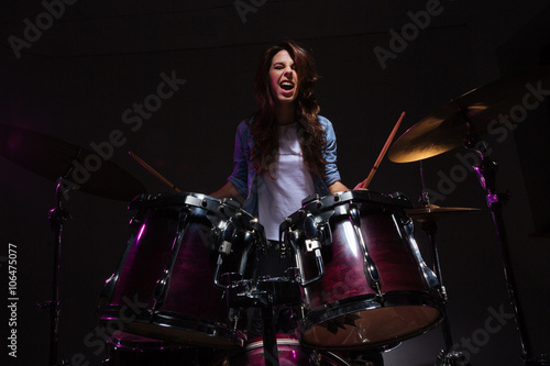 Woman playing the drums Fototapeta