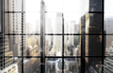 Large panoramic window with views of the city