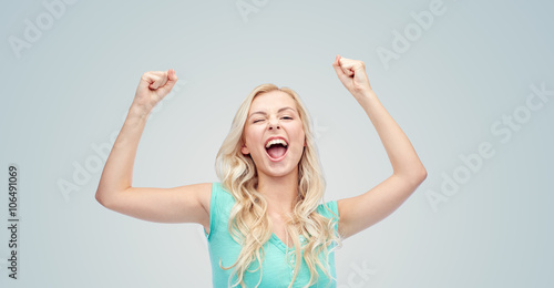 Fotografía  happy young woman or teen girl celebrating victory